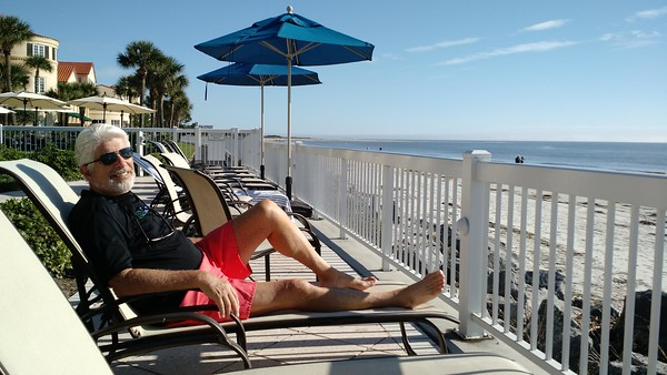 Boomer man relaxing on lounge chair at the beach