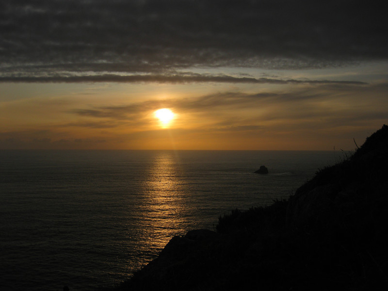 Enjoy a sunset at Cape Finisterre on a road trip through Spain's Lower Rias.