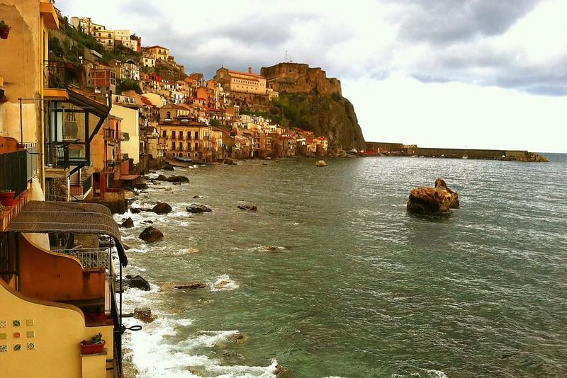 Ochre buildings hug the coast of off-the-beaten-path Calabria.