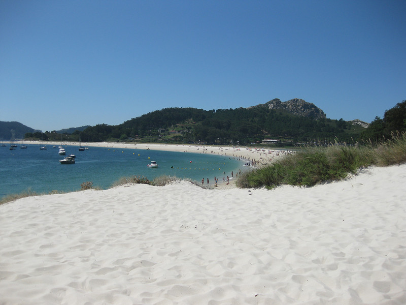 Enjoy the beach of the Cies Islands on a road trip through the Lower Rias of Spain.