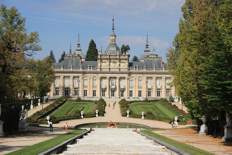 A slate roof covers the La Granja as the majestic building overlooks a park in fountains near Madrid, Spain.