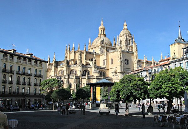 Cathedral with spires surrounded by trees in Segovia, Spain