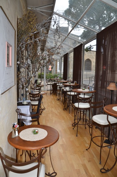 Glassed Conservatory at the Hotel de L'Horloge