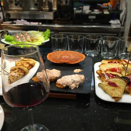 Pintxos and wine in a San Sebastian bar.
