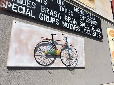 Bicycle mounted to the side of a building in Barcelona.