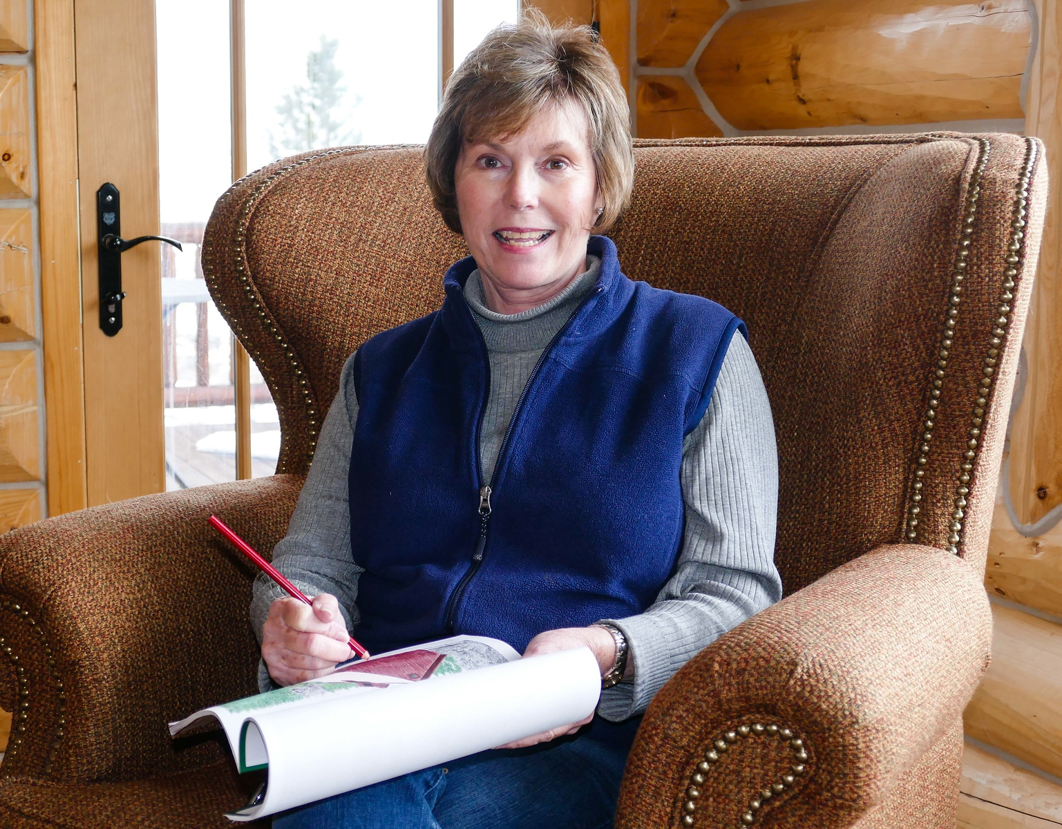 Donna Hull relaxes by coloring pages in Coloring the West, An Adult Coloring Book for Travelers.