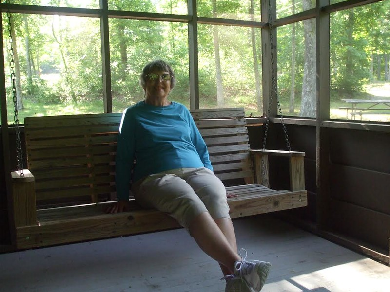 Woman relaxing on a porch swing