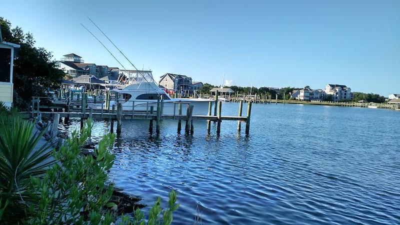 Houses and docks on a blue lake
