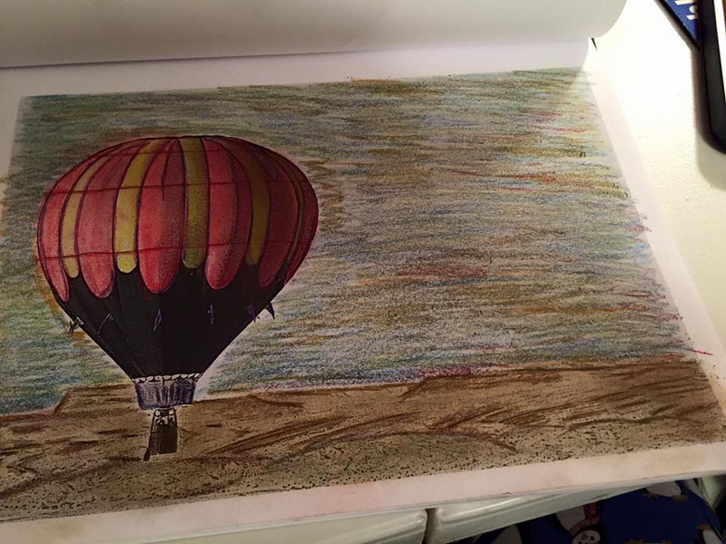 A page from Coloring the West that depicts the Bluff Hot Air Balloon Festival in Bluff, Utah.