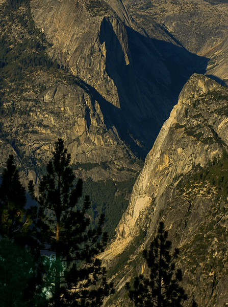 Looking down past a rocky landscape into Yosemite valley.