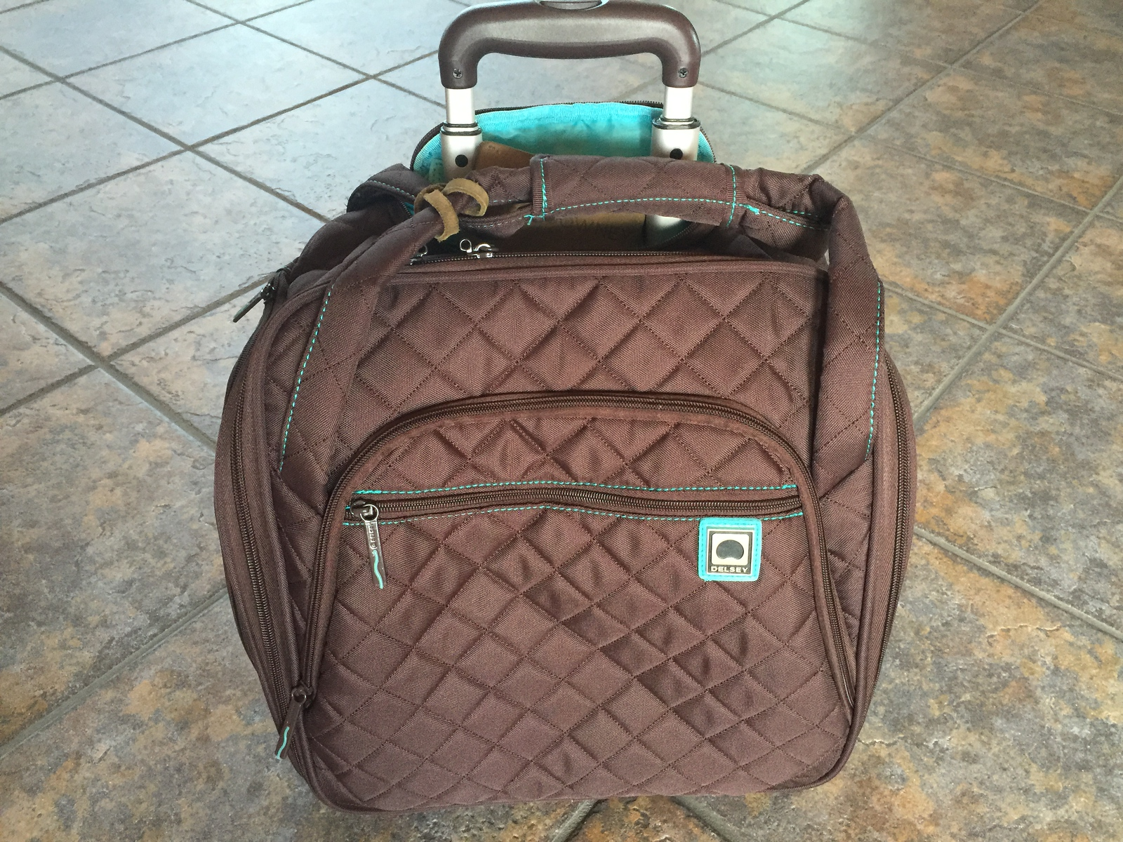 Delsey Quilted Rolling UnderSeat Tote is lightweight and fits easily under airplane seats.